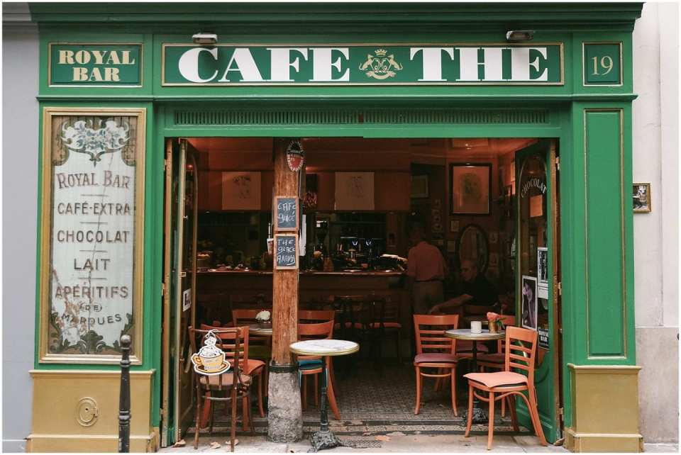 french cafe in Paris on a natural lit alley street and a croissant