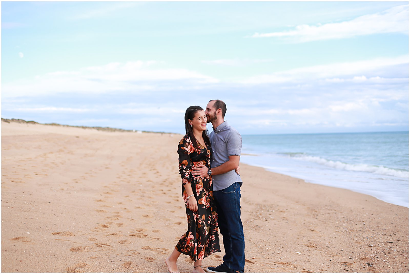 engaged couple photographed on the beach in algarve portugal