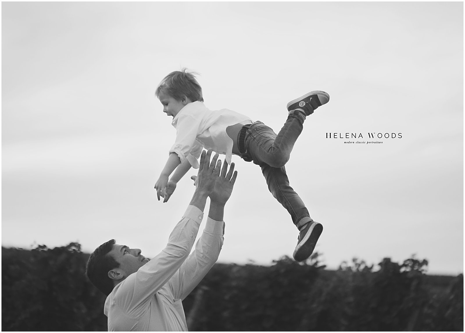 father and son jumping with destination family photographer helena woods