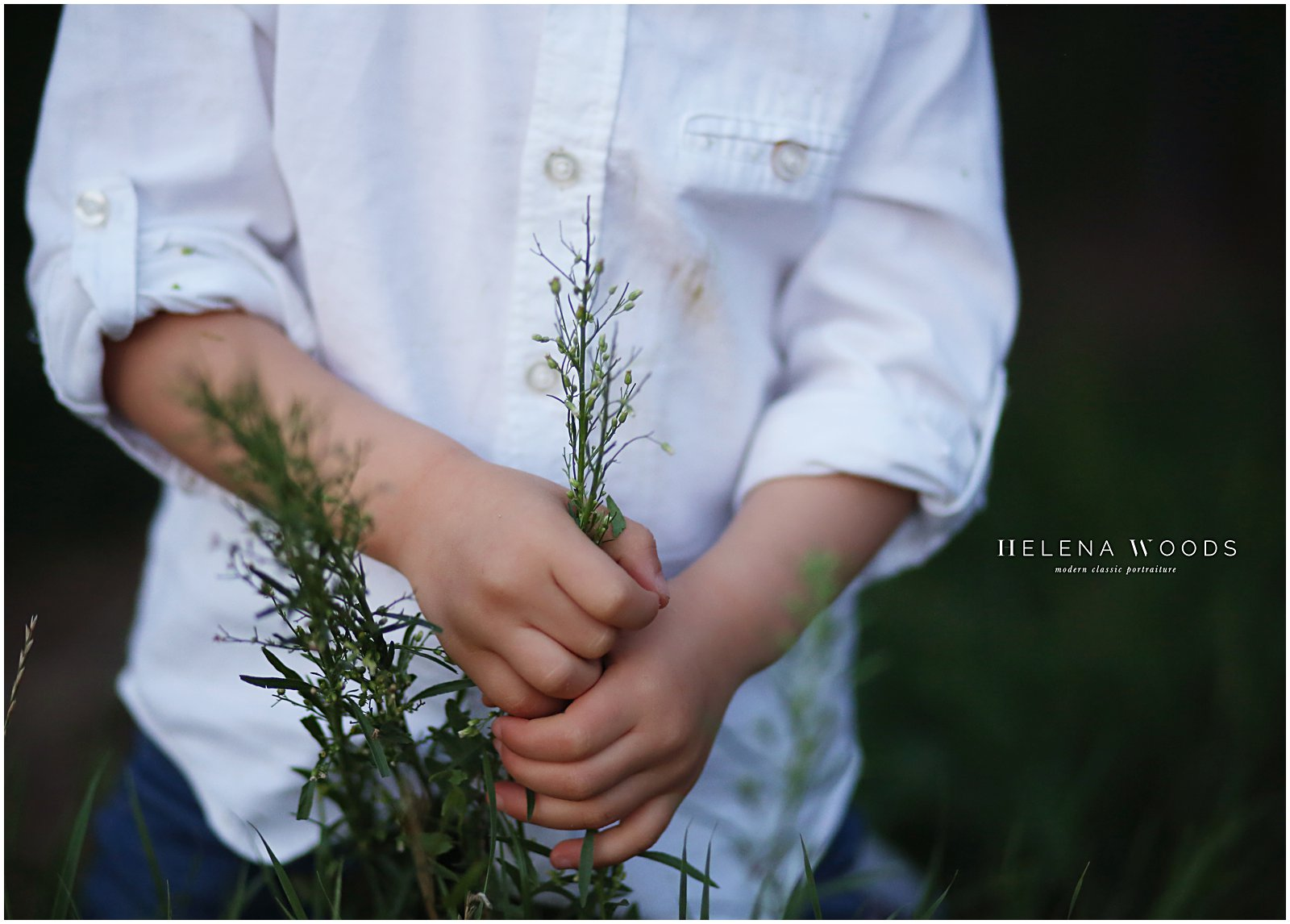 child playing with leaves and flowers photographed by children's photographer helena woods