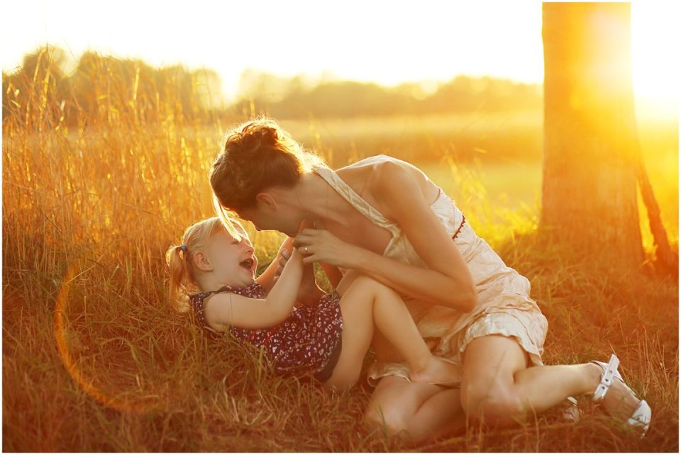 golden hour sunlight motherhood toddler laughing photographed by Connecticut family photographer Helena Woods