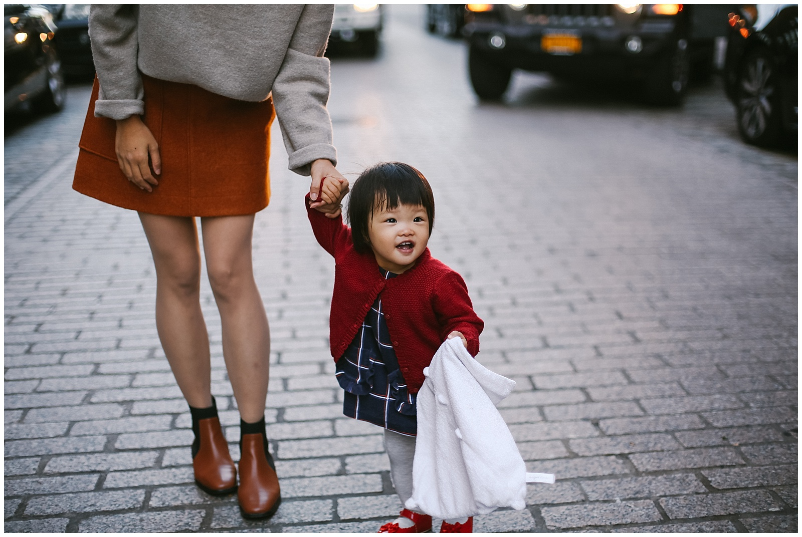 mom and baby smile for nyc family photographer in DUMBO water street