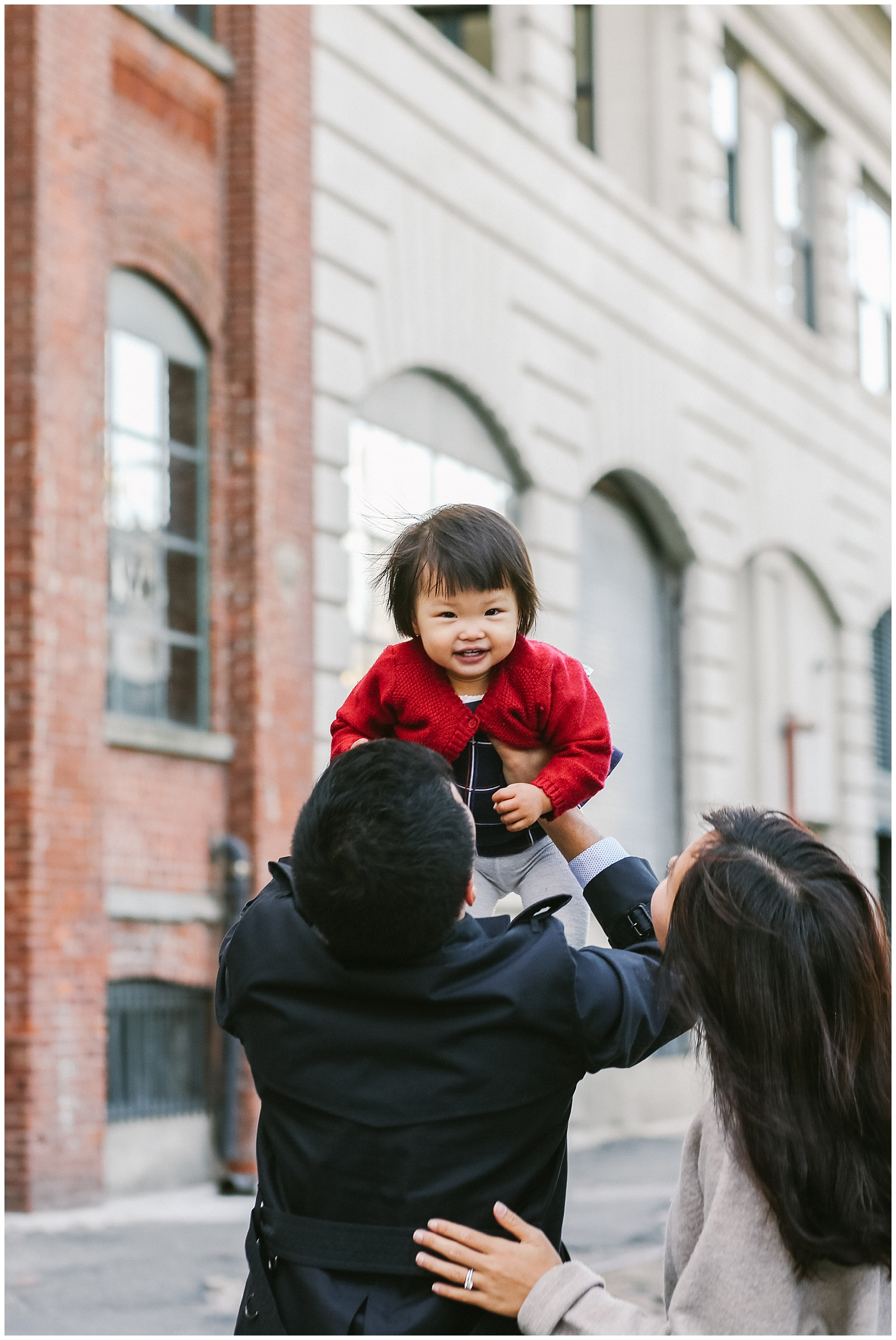 family with daughter playing in DUMBO Brooklyn for family photoshoot