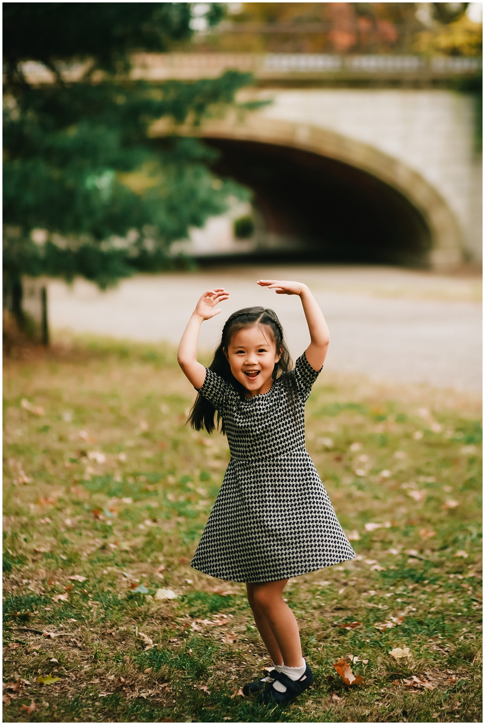 little girl dancing in central park with nyc family photographer helena woods