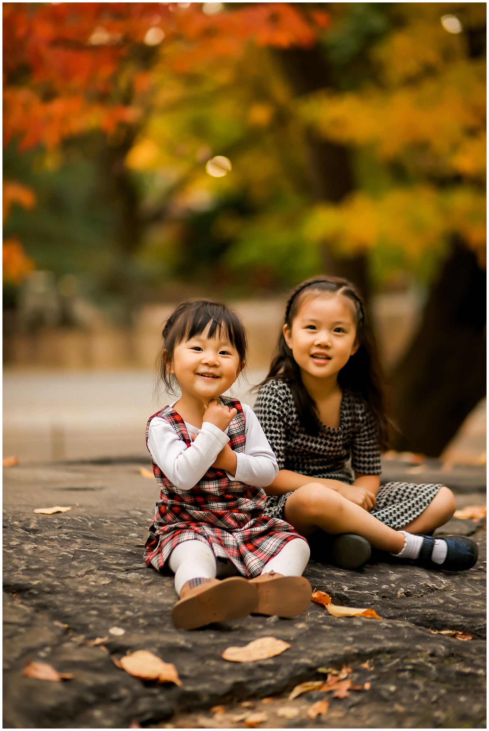 nyc family photographer photoshoot with two sisters in central park