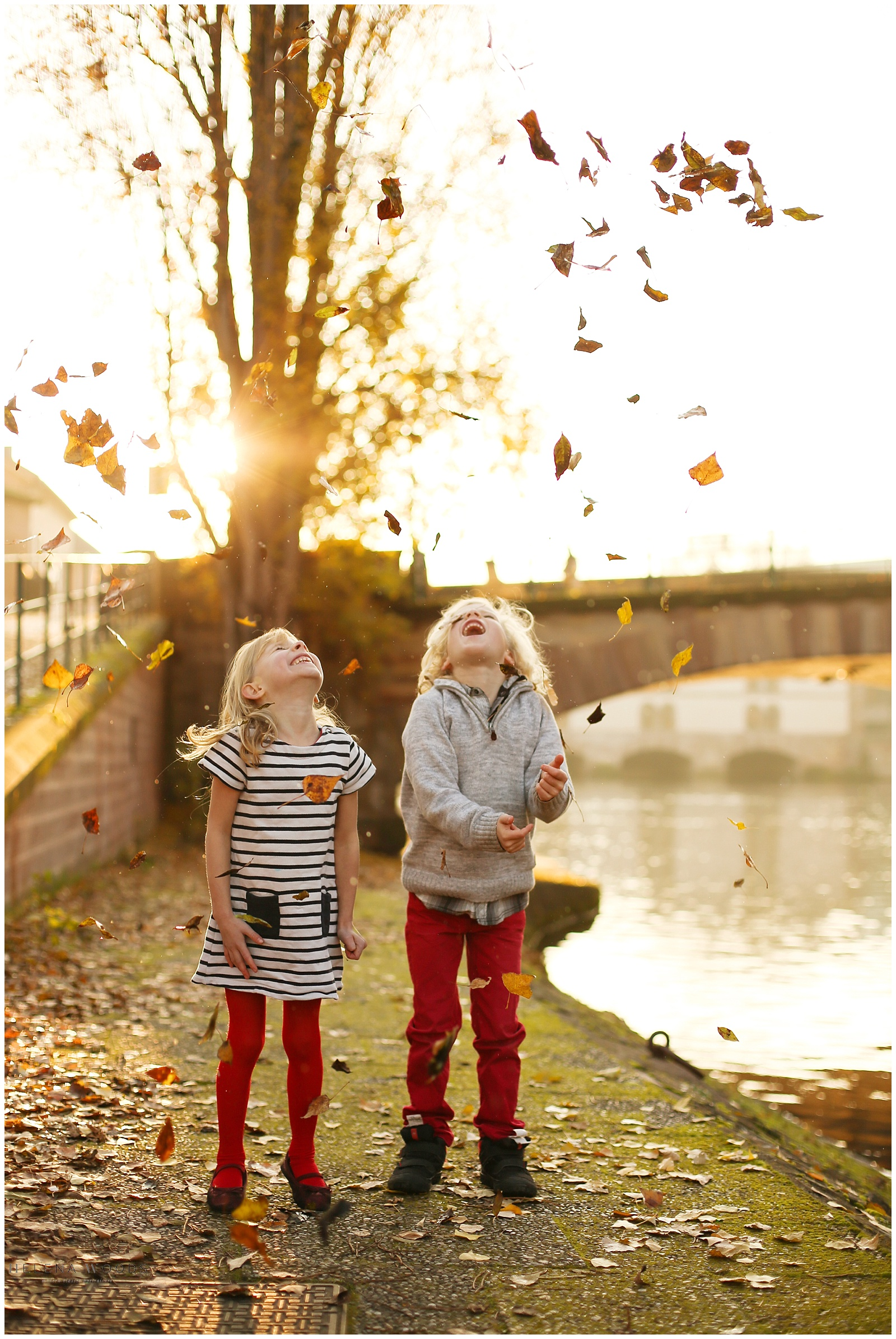 kids throwing leaves in Petite France Strasbourg France