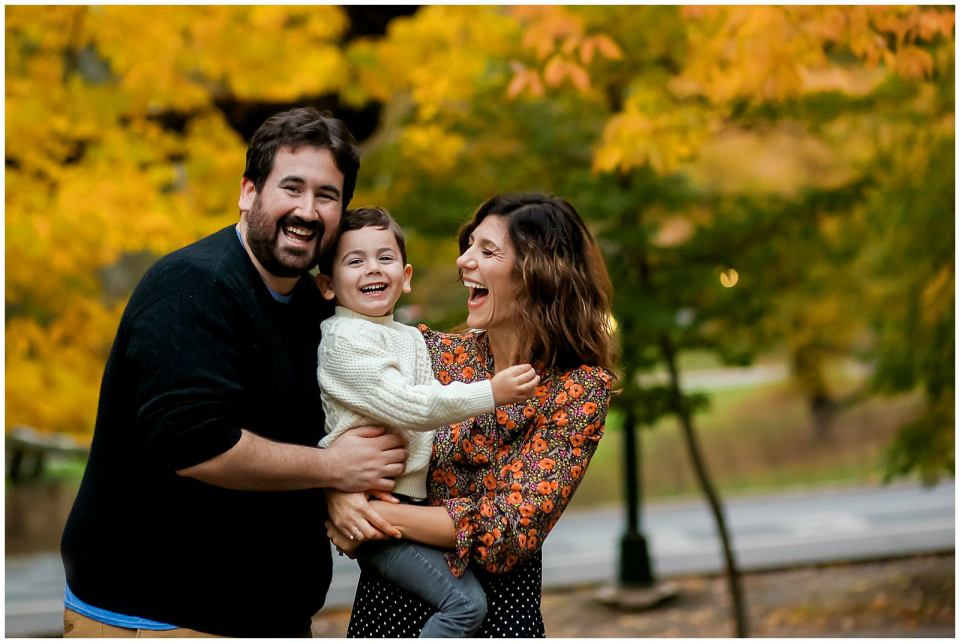 family laughing in New York City Central Park with family photographer Helena Woods
