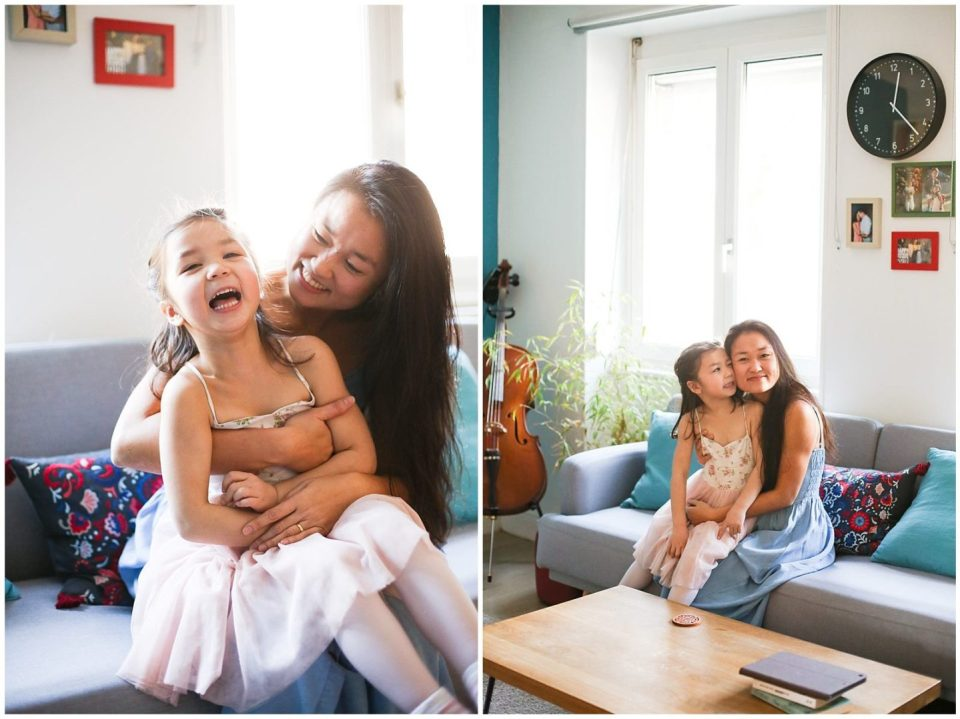 mother cuddles girl during Home Lifestyle Family Photo Session with Helena Woods Photography