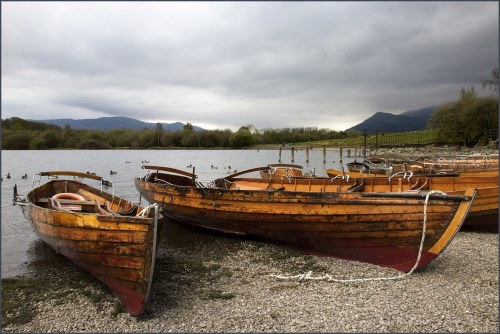 Rowing boats on Derwentwater keswick lake district england