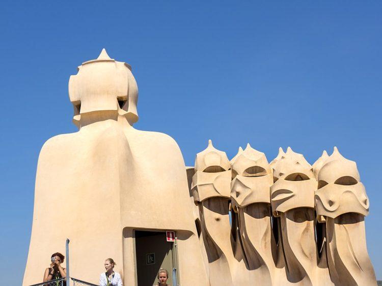 La Pedrera: The Garden of Warriors Gaudi chimney-pots faces Barcelona