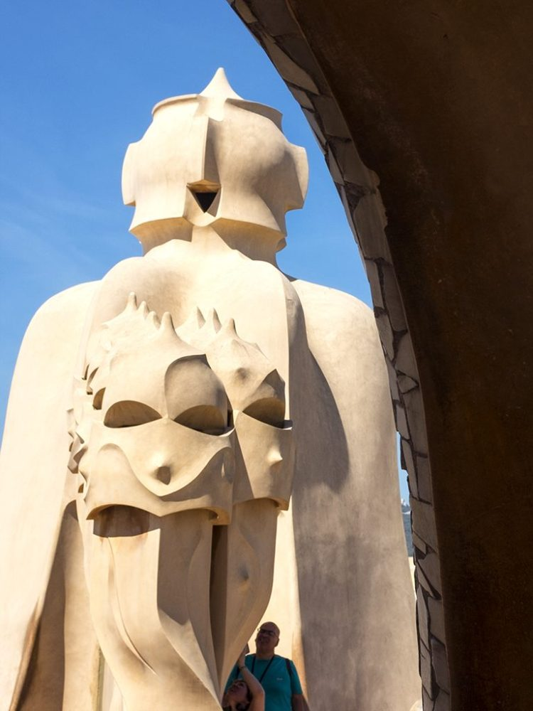 La Pedrera: Archway roof Gaudi Chimney-pots faces Barcelona