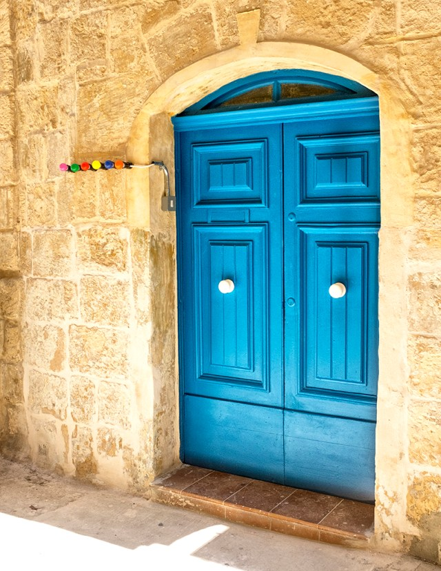 Blue Door with Coloured Light Bulbs Valletta blue Thursday Doors Malta