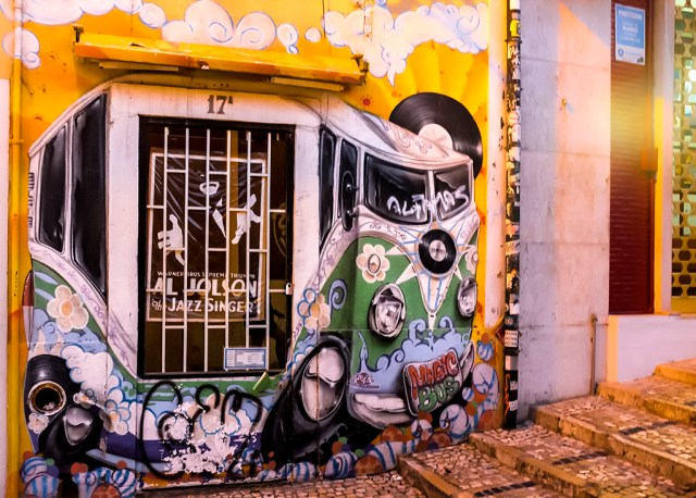 Entrance to Magic Bus Record Shop Lisbon dusk