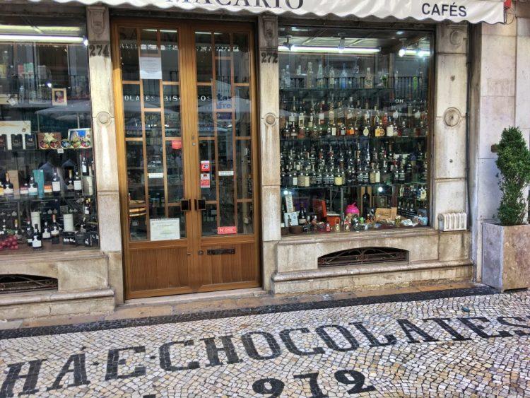 LISBON: Shop Signage Rua Augusta mosaic pavement