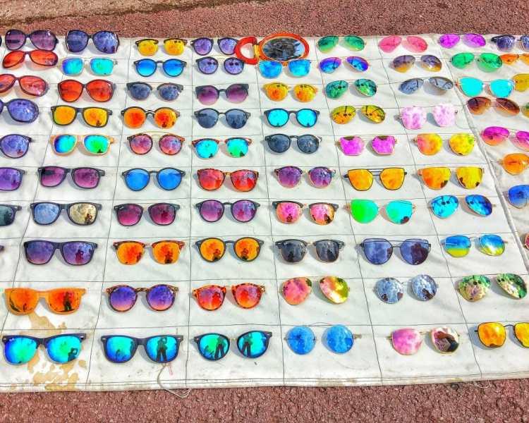 rainbow colours of sunglasses on display