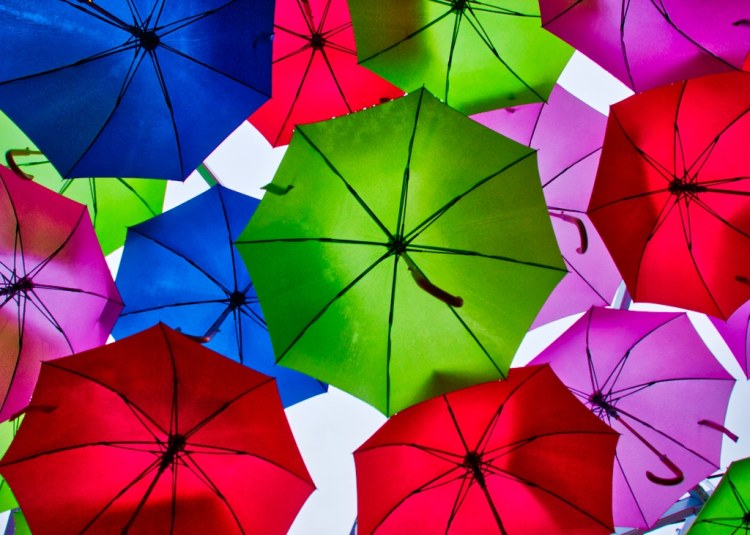 rainbow colours of umbrellas in london street