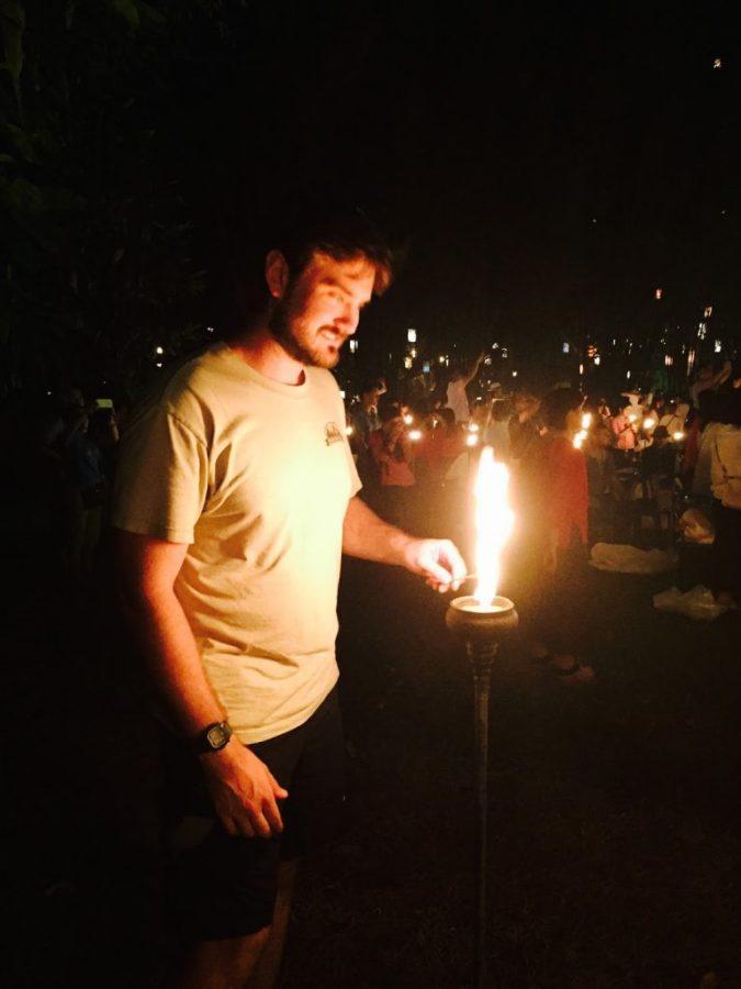 lighting the lantern at Yi Peng
