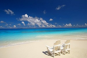 Two deck chairs on tropical beach facing sea, Maldives, Indian Ocean, Asia