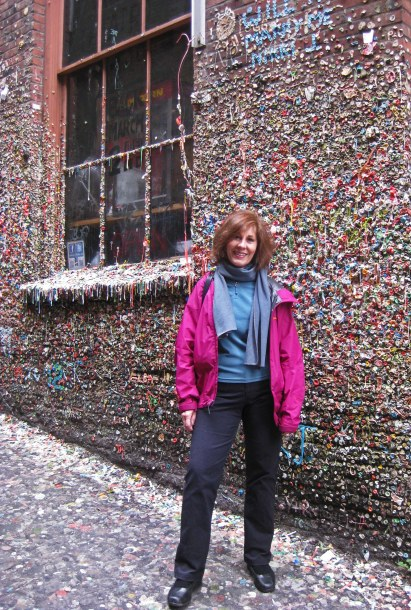 I'm in a sticky situation at Seattle's Gum Wall. (Photo: Helen Holter)
