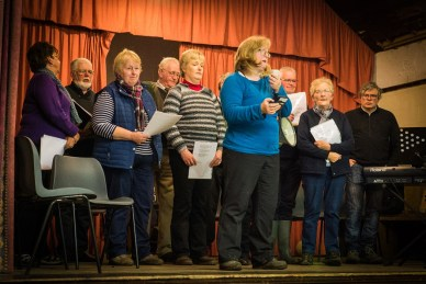 Karen Giffiths stands with the choir in Keld Hall