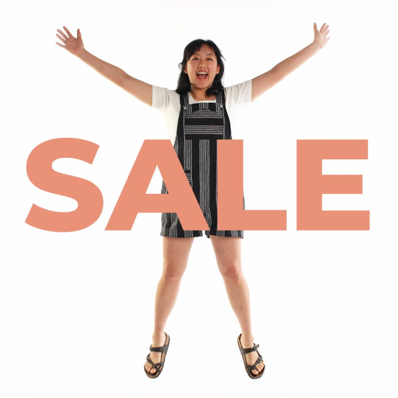 Woman jumping with SALE text