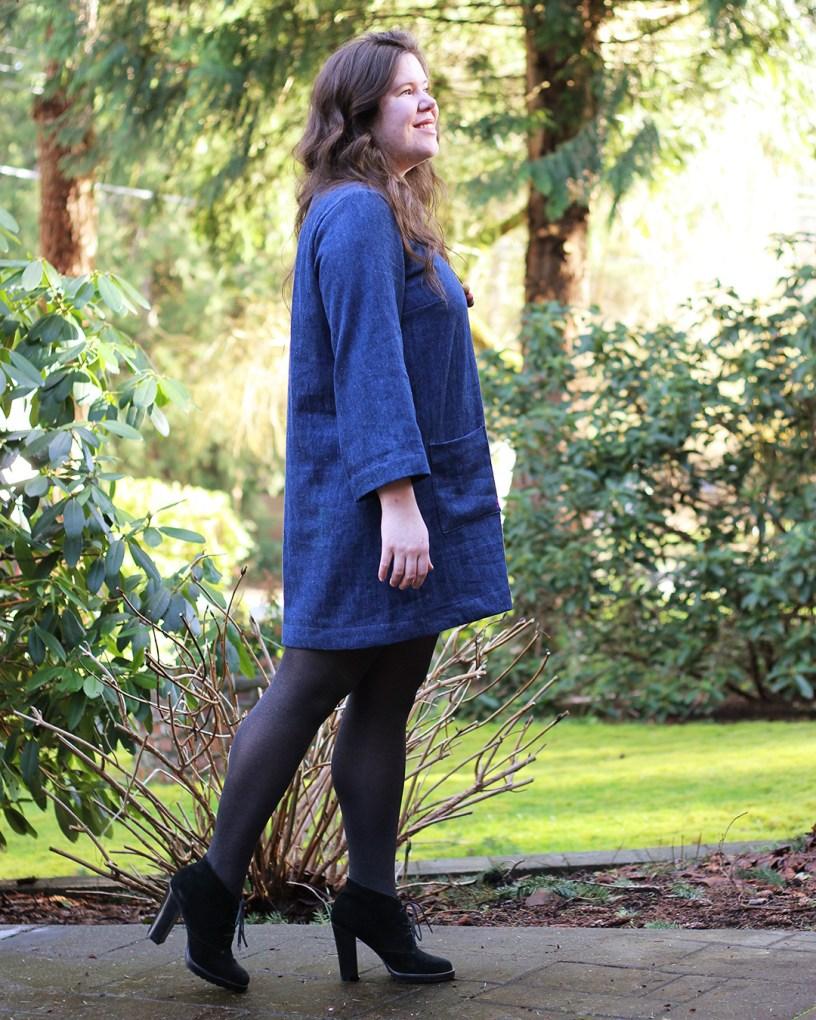 Ashton denim dress with long sleeves, side view.