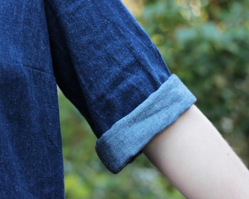 Close up of rolled denim sleeves on Ashton sleeve expansion.