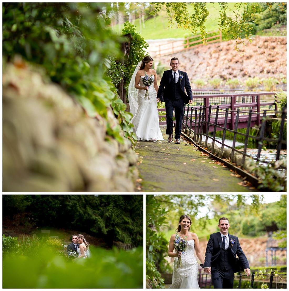 Bride and groom walking through the gardens at The Raithwaite Estate
