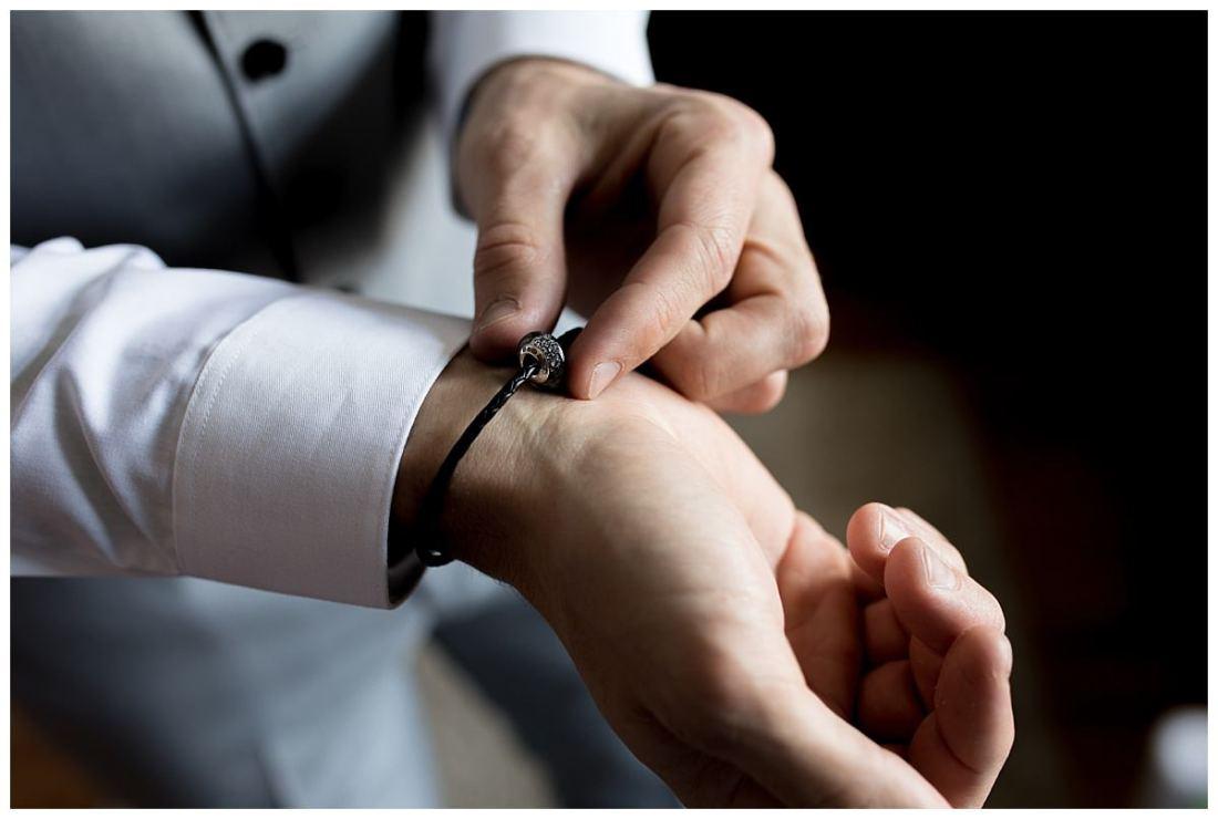 Groom adjusting jewellery