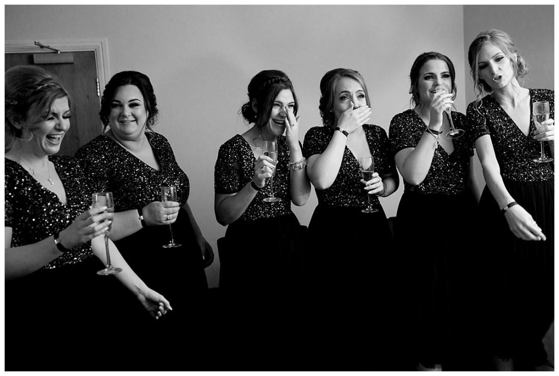 Bridesmaids seeing bride in dress