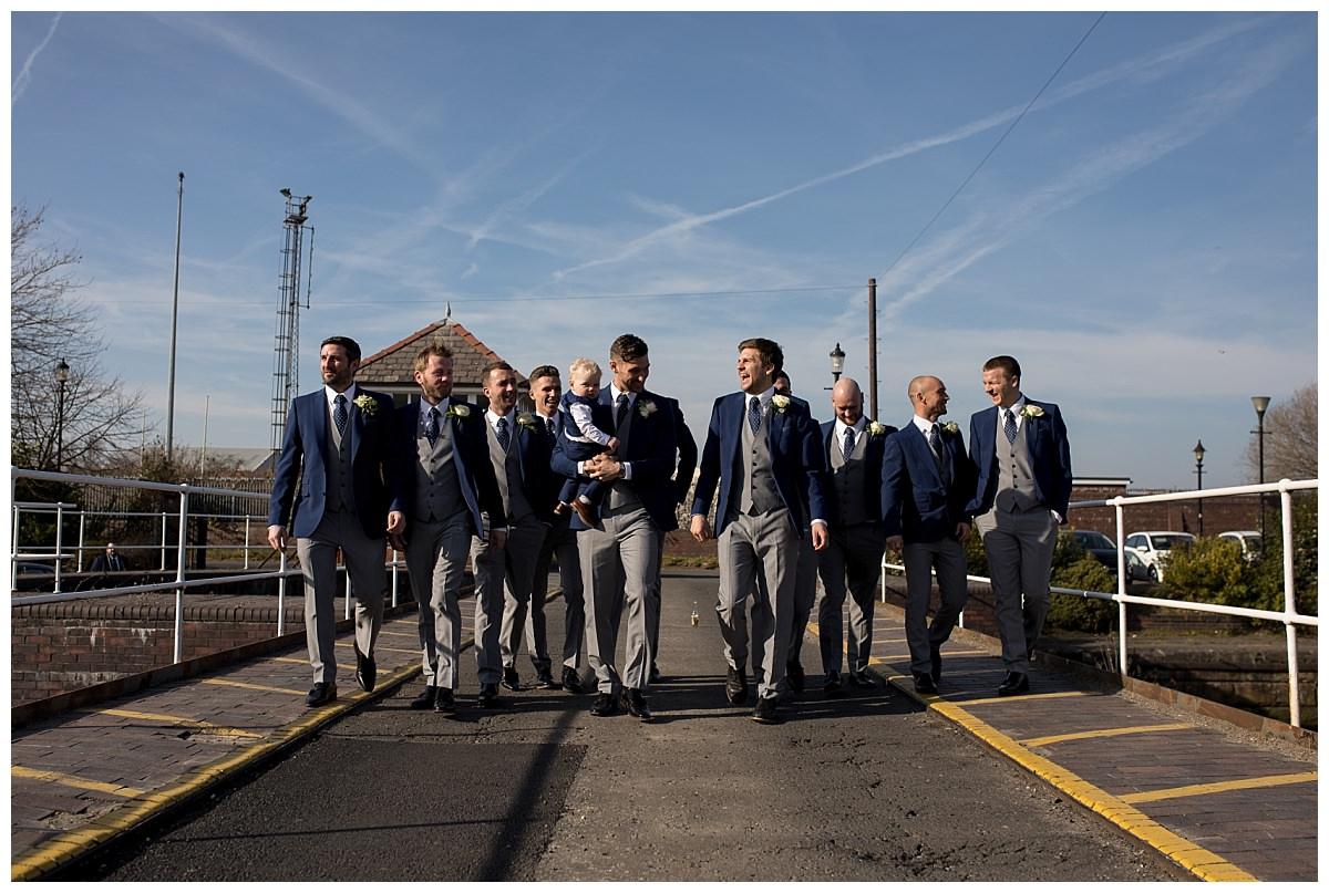 Groomsmen walking photo