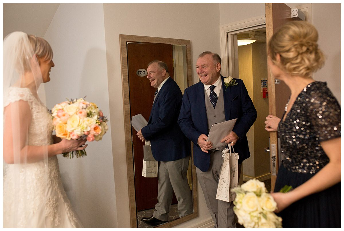 Father of the bride seeing daughter for the first time