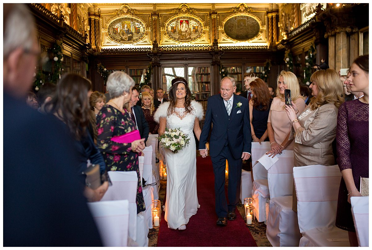 Bride walking down the aisle with her father at Crewe Hall, Cheshire