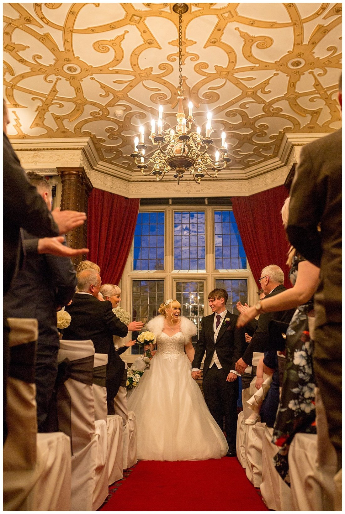 Bride and groom walking down the aisle at Crewe Hall