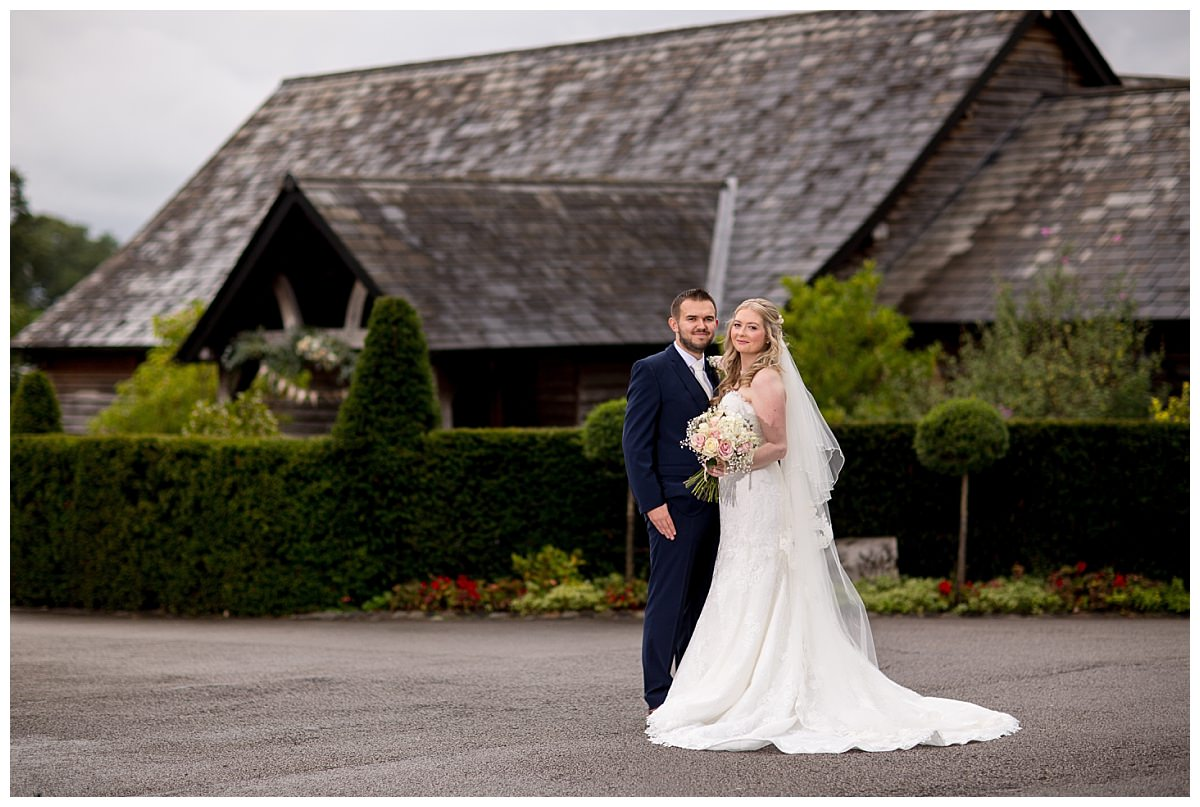 Bride and groom stood infront of Sandhole Oak Barn