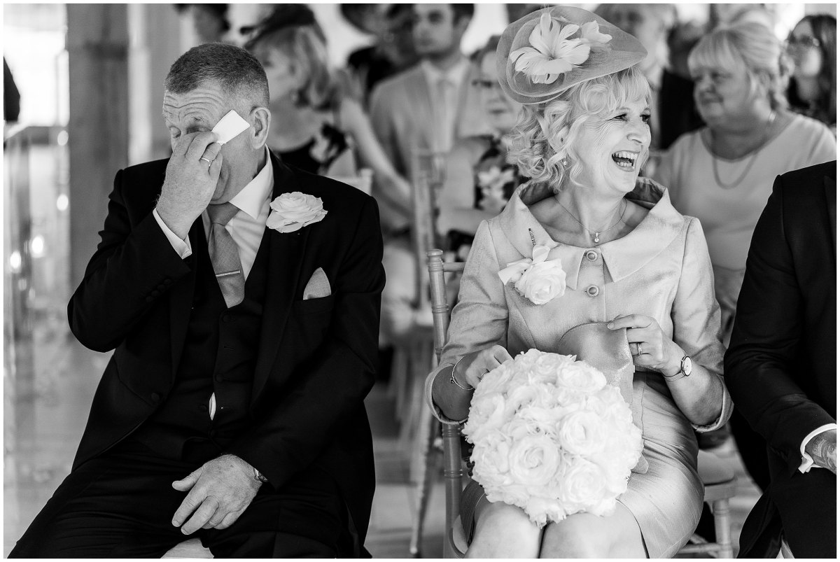 Father of the bride crying during wedding ceremony