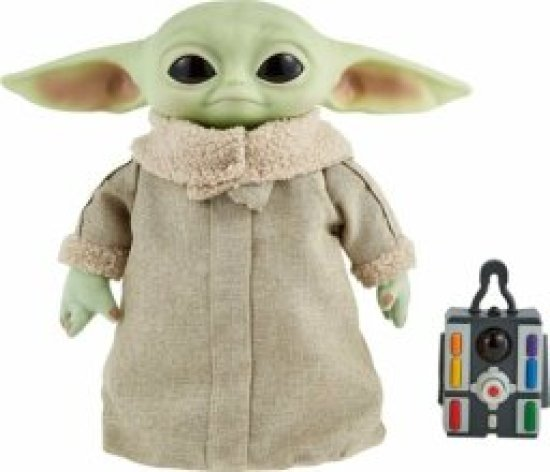 a baby yoda toy with a remote