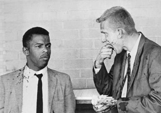 Lewis stands with fellow Freedom Rider James Zwerg after being attacked in Montgomery, Alabama in 1961.