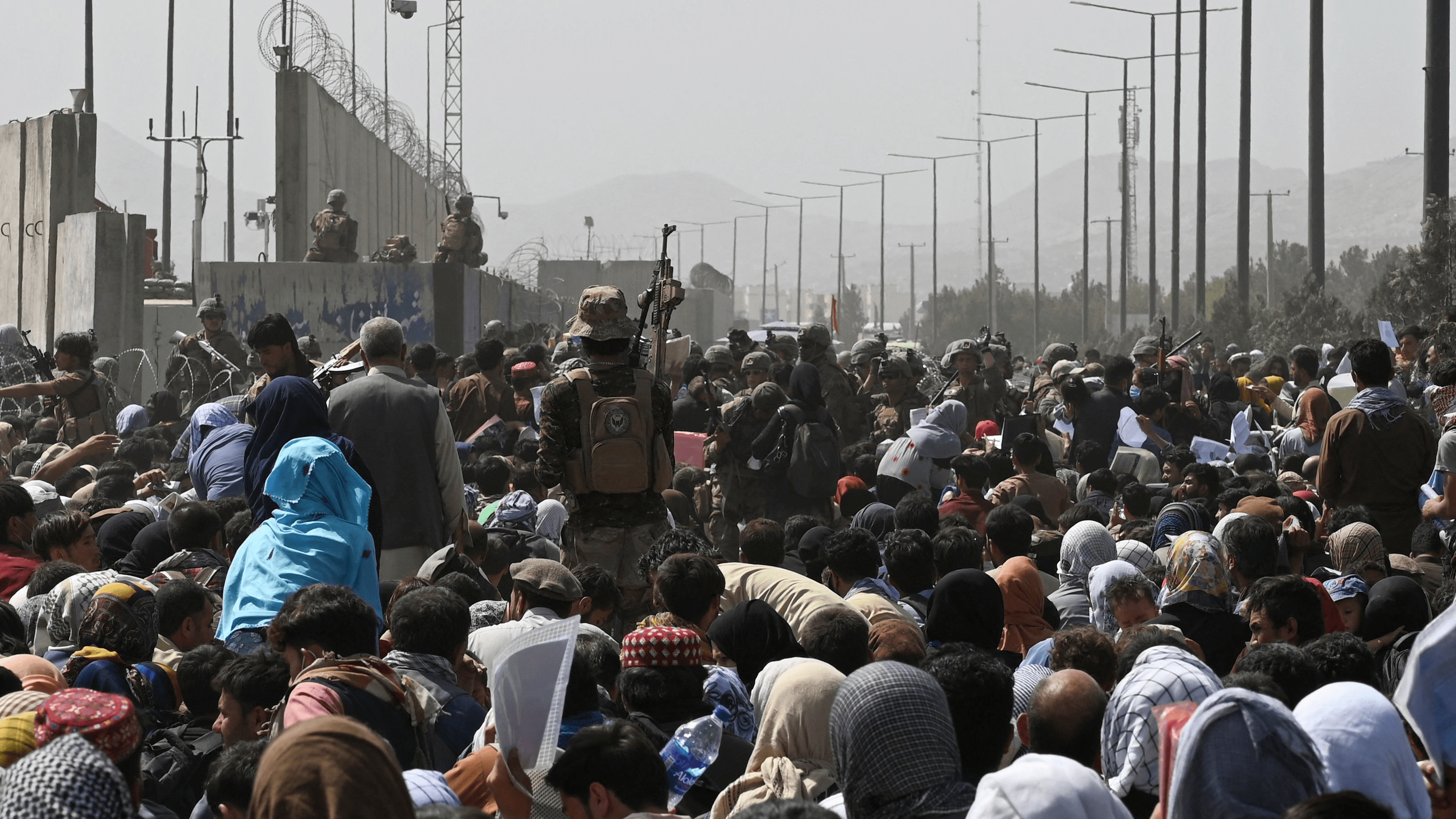 Afghans gather near the Kabul airport, hoping to flee the country. GoFundMe campaigns offer a way to help Afghans in crisis.