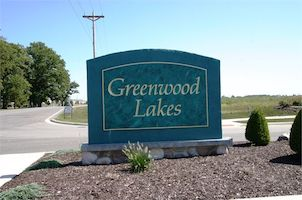 A picture of the entrance sign for Greenwood Lakes Communities