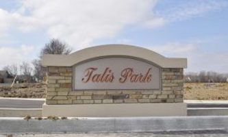 A picture of the entrance sign for Talis Park Communities