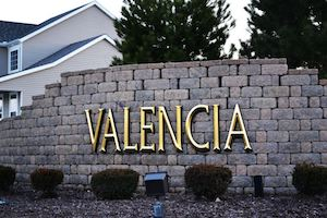 A picture of the entrance sign for Valencia Communities