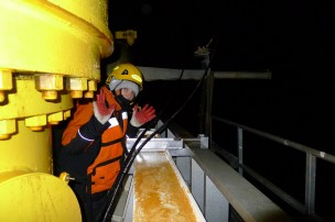 Ketelyn in the back deck, around 4am, after finishing a long day of coring