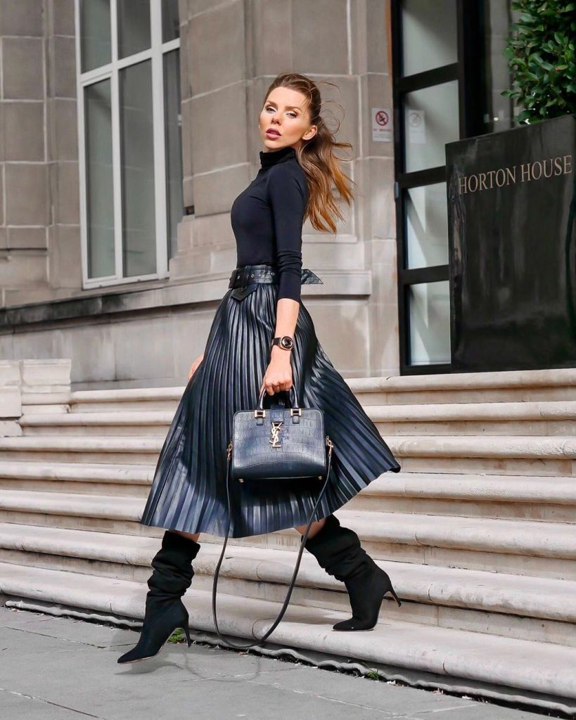 stylish woman wearing fall outfit for work business casual idea black turtle neck and black boots
