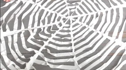 Remove the painter's tape and gently open the spider web!  Hang it up and admire your gorgeous EASY DIY Halloween project!