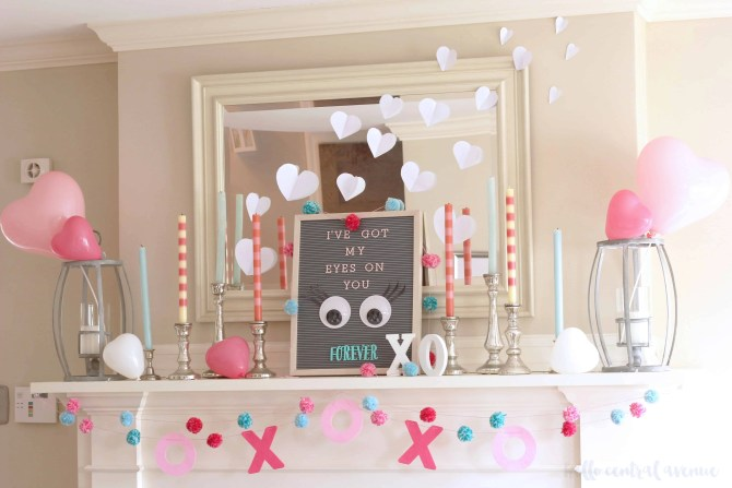 Decorate your mantle with pink, white, and red this Valentine's Day! Your Valentine's Day Mantle can include heart-shaped balloons, pink striped candles, googly eyed letterboard, and diy valentine's day garlands.