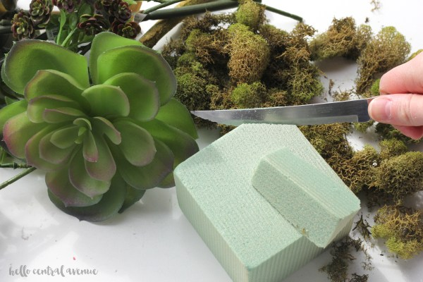 Use a Target dollar spot ceramic bunny to create a faux (or real) succulent planter for spring!
