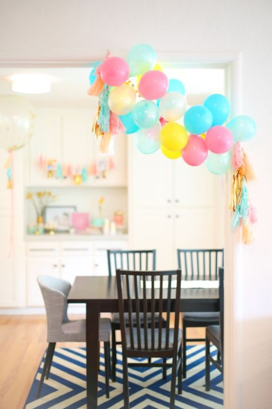 Colorful balloon garland by Lovely Indeed-inspiration for dessert table balloon garland