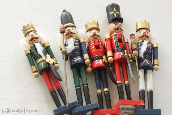 You can totally update your Christmas decor by spray painting your nutcracker decorations! It's a cheap and easy DIY! By painting them gold and white, they become more modern and classic, and can fit into any style of decor.