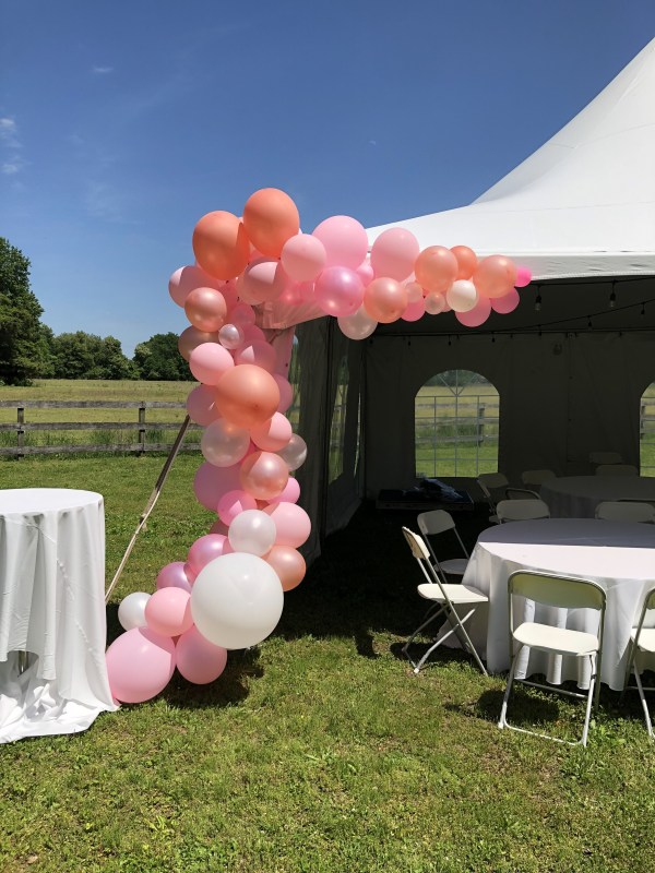 Balloon arch kit completed on white tent